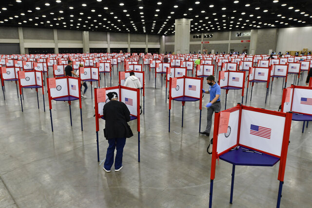 "FILE - In this June 23, 2020, file photo voting stations are set up in the South Wing of the Kentucky Exposition Center for voters to cast their ballot in the Kentucky primary in Louisville, Ky. Just over four months before Election Day, President Donald Trump is escalating his efforts to delegitimize the upcoming presidential election. Last week he made a startling, and unfounded, claim that 2020 will be ""the most corrupt election in the history of our country."
