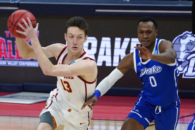 USC guard Drew Peterson (13) drives on Drake guard D.J. Wilkins (0) during the first half of a men's college basketball game in the first round of the NCAA tournament at Bankers Life Fieldhouse in Indianapolis, Saturday, March 20, 2021. (AP Photo/Paul Sancya)