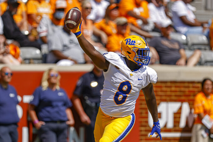 Pittsburgh quarterback Kenny Pickett (8) celebrates a touchdown catch during the first half of an NCAA college football game against Tennessee, Saturday, Sept. 11, 2021, in Knoxville, Tenn. (AP Photo/Wade Payne)