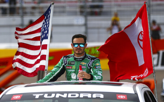 Kyle Larson looks on before a NASCAR Cup Series auto race at the Las Vegas Motor Speedway on Sunday, Sept. 15, 2019. (AP Photo/Chase Stevens)