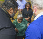 Lowndes County resident Charlie Mae Holcombe, center, prays with Rev. William Barber II, left, leader of the Moral Mondays movement, and former U.S. Vice President Al Gore, founder of the Climate Reality Project, Thursday, Feb. 21, 2019, after discussing the failing wastewater sanitation system at Holcombe's home to in Hayneville, Ala. (AP Photo/Julie Bennett)