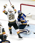 Vegas Golden Knights' William Carrier (28) celebrates after scoring past St. Louis Blues goaltender Ville Husso (35) during the second period of an NHL hockey game Monday, April 5, 2021, in St. Louis. (AP Photo/Jeff Roberson)