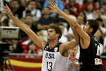 United States' Brook Lopez holds back Japan's Kosuke Takeuchi during a Group E match for the FIBA Basketball World Cup at the Shanghai Oriental Sports Center in Shanghai on Thursday, Sept. 5, 2019. (AP Photo/Ng Han Guan)