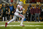 Ohio State linebacker Haskell Garrett recovers a fumble by Minnesota and returns it for a touchdown in the fourth quarter of an NCAA college football game Thursday, Sept. 2, 2021, in Minneapolis. (AP Photo/Bruce Kluckhohn)
