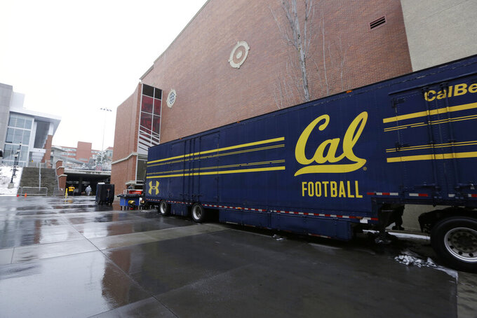 The California team equipment trailer sits outside Martin Stadium after the NCAA college football game between Washington State and California was canceled because of a case of COVID-19 on the Cal team, Saturday, Dec. 12, 2020, in Pullman, Wash. (AP Photo/Young Kwak)