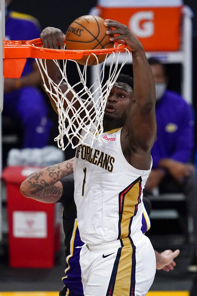 New Orleans Pelicans forward Zion Williamson dunks during the third quarter of the team's NBA basketball game against the Los Angeles Lakers on Friday, Jan. 15, 2021, in Los Angeles. (AP Photo/Ashley Landis)