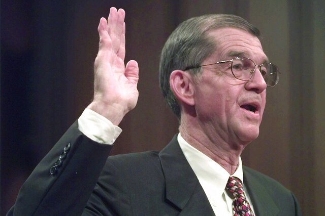 "FILE - Former Chairman of the Democratic National Committee Don Fowler takes the oath as he appears before the Senate Committee on Governmental Affairs in Washington, in this Tuesday, Sept. 9, 1997, file photo. Don Fowler, a former chair of the Democratic National Committee and mainstay of South Carolina and national politics for decades, has died. He was 85. Trav Robertson, chairman of South Carolina's Democratic Party, said on Twitter Fowler died Tuesday night, Dec. 15, 2020, calling him ""the ""Democrat's Democrat."