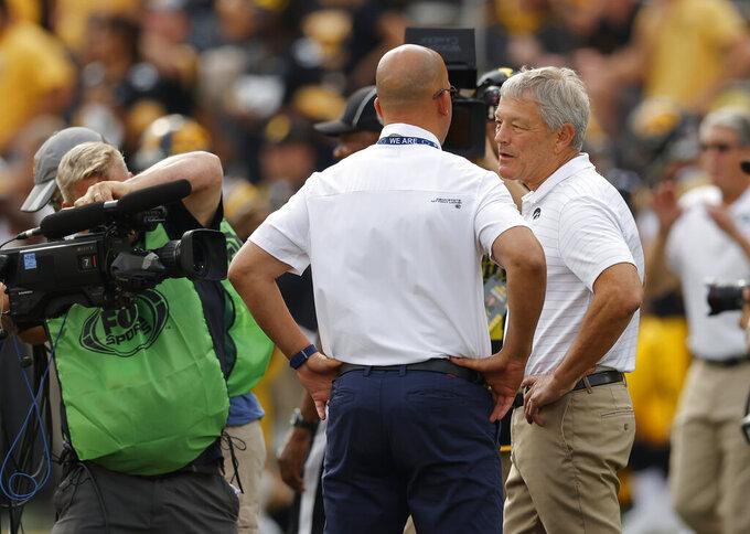 Iowa head coach Kirk Ferentz, right, talks with Penn State head coach James Franklin before an NCAA college football game, Saturday, Oct. 9, 2021, in Iowa City, Iowa. (AP Photo/Matthew Putney)