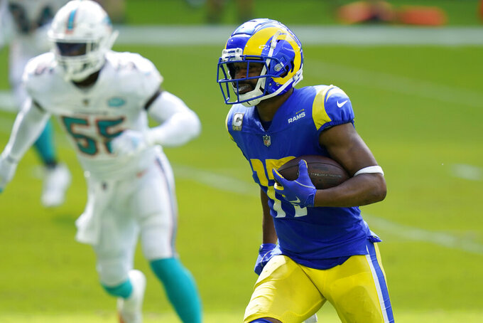 Los Angeles Rams wide receiver Robert Woods (17) runs for a touchdown during the first half of an NFL football game against the Miami Dolphins, Sunday, Nov. 1, 2020, in Miami Gardens, Fla. (AP Photo/Lynne Sladky)