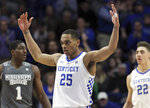 Kentucky's PJ Washington urges the crowd on near teammate Reid Travis (22) and Mississippi State's Reggie Perry (1) during the second half of an NCAA college basketball game in Lexington, Ky., Tuesday, Jan. 22, 2019. Kentucky won 76-55. (AP Photo/James Crisp)