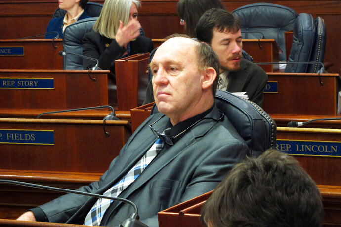 FILE - This Feb. 12, 2018 file photo, Alaska state Rep. Gary Knopp waits during a break in a floor session in which the House failed to elect a permanent speaker  in Juneau, Alaska. The Alaska House Majority says Knopp was killed in the mid-air collision of two planes near Soldotna on Friday, July 31, 2020. Alaska State Troopers would not confirm Knopp's death beyond saying the mid-air collision near the airport in Soldotna was a fatal crash. (AP Photo/Becky Bohrer, File)