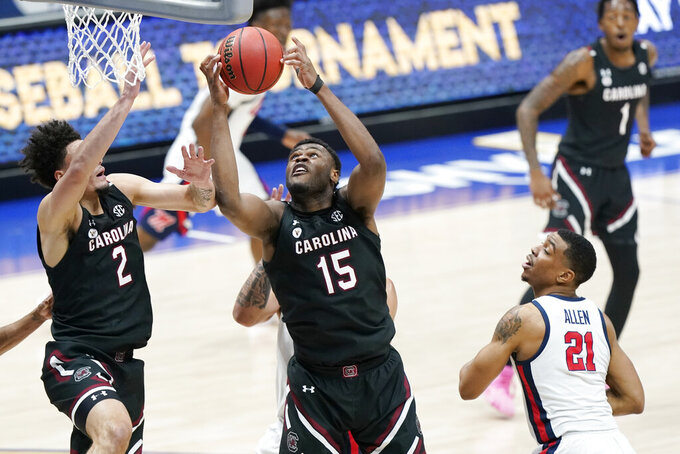 South Carolina's Wildens Leveque (15) grabs a rebound in front of Mississippi's Robert Allen (21) in the first half of an NCAA college basketball game in the Southeastern Conference Tournament Thursday, March 11, 2021, in Nashville, Tenn. (AP Photo/Mark Humphrey)