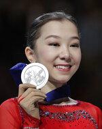 Kazakhstan's Elizabet Tursynbaeva displays her silver medal for the ladies free skating during the ISU World Figure Skating Championships at Saitama Super Arena in Saitama, north of Tokyo, Friday, March 22, 2019. (AP Photo/Andy Wong)