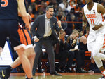 Virginia head coach Tony Bennett, center, celebrates a basket by his players during the second half of an NCAA college basketball game against Syracuse in Syracuse, N.Y., Monday, March 4, 2019. Virginia beat Syracuse 79-53. (AP Photo/Adrian Kraus)