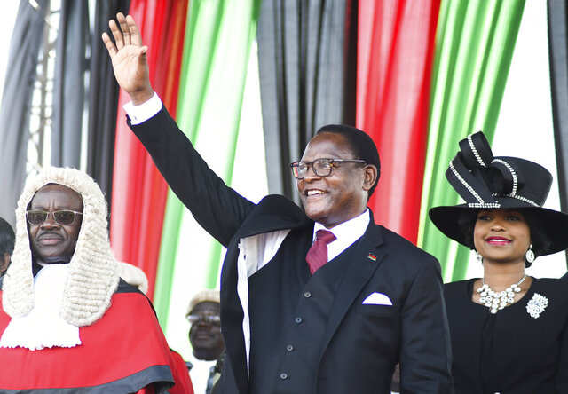 Malawi's newly elected President Lazarus Chakwera greets supporters after being sworn in in Lilongwe, Malawi, Sunday, June 28 2020. Chakwera is Malawi's sixth president after winning the historic election held last week, the first time a court-overturned vote in Africa has resulted in the defeat of an incumbent leader. (AP Photo/Thoko Chikondi)