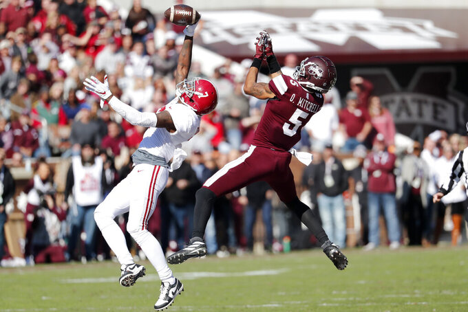 FILE - In this Nov. 16,2019, file photo, Alabama defensive back Trevon Diggs (7), left,  knocks away a pass to Mississippi State wide receiver Osirus Mitchell (5) during the first half of an NCAA college football game, in Starkville, Miss. Diggs was selected to The Associated Press All-Southeastern Conference football team, Monday, Dec. 9, 2019. (AP Photo/Rogelio V. Solis, File)
