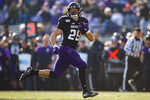 Northwestern's Evan Hull runs to score a touchdown against Massachusetts during the second half of an NCAA college football game Saturday, Nov. 16, 2019, in Evanston, Ill. (AP Photo/Jim Young)