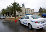 A police vehicle outside the mosque in Malmesbury, near Cape Town, South Africa, Thursday June 14 2018. A man fatally stabbed two people on Thursday and wounded several others at a mosque near Cape Town before police shot and killed the attacker, authorities said. (AP Photo Nasief Manie)