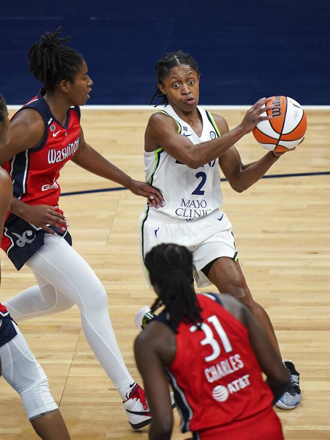 Minnesota Lynx guard Crystal Dangerfield (2) passes the ball in the second half of a WNBA basketball game against the Washington Mystics in Minneapolis, Saturday, May 8, 2021. (Renee Jones Schneider/Star Tribune via AP)