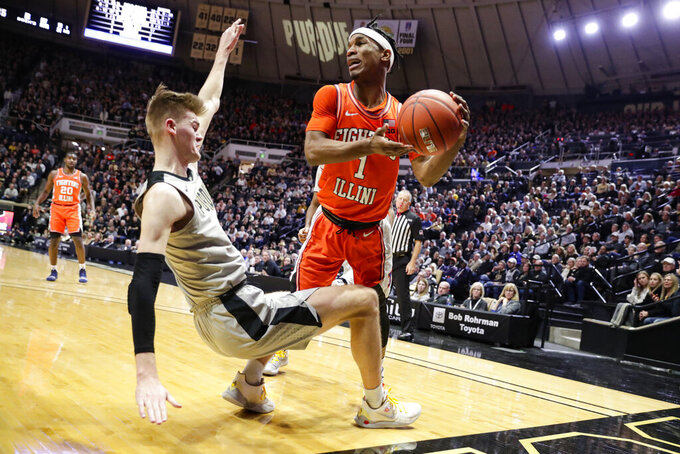 Purdue center Matt Haarms (32) draws the charge from Illinois guard Trent Frazier (1) during the first half of an NCAA college basketball game in West Lafayette, Ind., Tuesday, Jan. 21, 2020. (AP Photo/Michael Conroy)