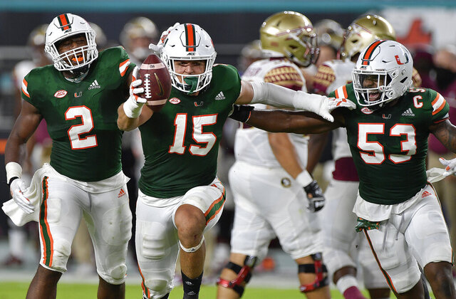 Miami lineman Jaelan Phillips celebrates after  intercepting a pass from Florida State during the first half of an NCAA college football game, Saturday, Sept. 26, 2020, in Miami Gardens, Fla. (Michael Laughlin/South Florida Sun-Sentinel via AP)
