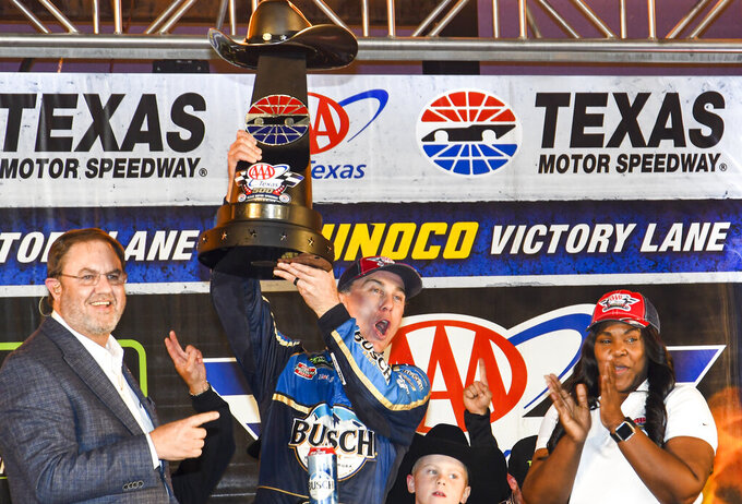 Kevin Harvick celebrates in Victory Lane after winning a NASCAR Cup Series auto race at Texas Motor Speedway, Sunday, Nov. 3, 2019, in Fort Worth, Texas. (AP Photo/Randy Holt)