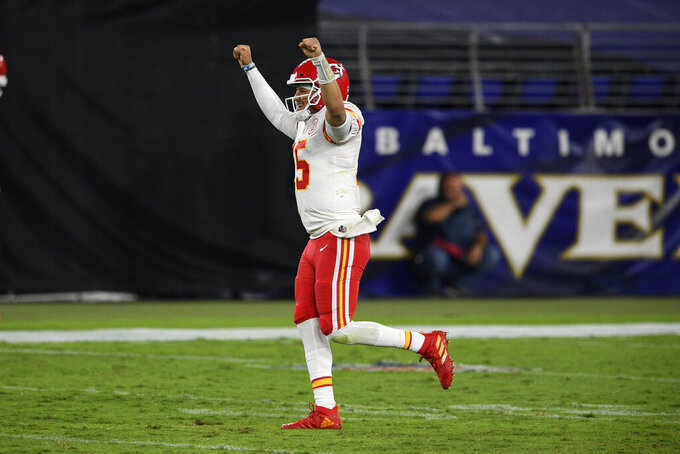 Kansas City Chiefs quarterback Patrick Mahomes celebrates his touchdown pass to offensive tackle Eric Fisher during the second half of an NFL football game against the Baltimore Ravens, Monday, Sept. 28, 2020, in Baltimore. (AP Photo/Nick Wass)