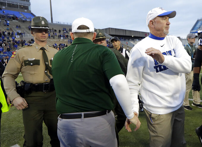 Middle Tennessee coach Rick Stockstill, right, shakes hands with UAB coach Bill Clark after the Conference USA NCAA championship college football game Saturday, Dec. 1, 2018, in Murfreesboro, Tenn. UAB won 27-25. (AP Photo/Mark Humphrey)