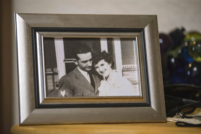 In this Aug. 26, 2021, photo, a photograph of Thomas and Dee House is displayed in their home in Las Cruces, N.M. A chance meeting on July 18, 1946 and three weeks together — that was the beginning of Thomas and Dee House's 75-year marriage. (Nathan J Fish/The Las Cruces Sun News via AP)