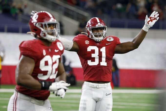FILE - Alabama defensive lineman Justin Eboigbe (92) and linebacker Will Anderson Jr. (31) celebrate after a missed Notre Dame field goal attempt in the first half of the Rose Bowl NCAA college football game in Arlington, Texas, in this Friday, Jan. 1, 2021, file photo. Anderson was selected to The Associated Press Preseason All-America first team defense, Monday Aug. 23, 2021.(AP Photo/Michael Ainsworth, File)
