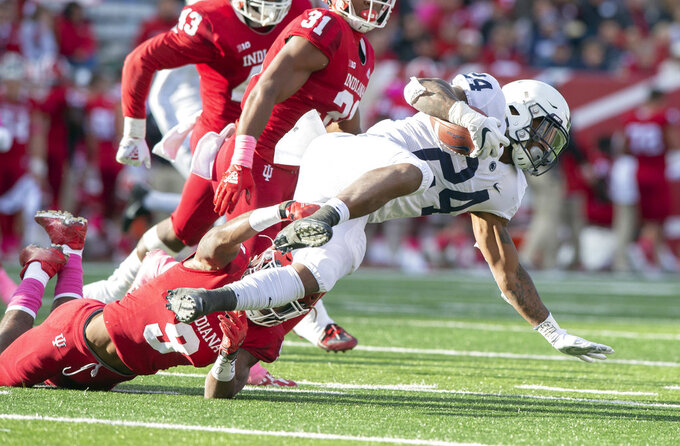 Indiana defensive back Jonathan Crawford (9) tackles Penn State running back Miles Sanders (24) as he rushes the ball up field during the first half of an NCAA college football game Saturday, Oct. 20, 2018, in Bloomington, Ind. (AP Photo/Doug McSchooler)