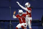 Arizona Cardinals' Kyler Murray (1) and DeAndre Hopkins, right, celebrate a touchdown scored on a carry by Murray in the second half of an NFL football game against the Dallas Cowboys in Arlington, Texas, Monday, Oct. 19, 2020. (AP Photo/Ron Jenkins)
