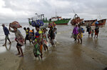 Displaced families arrive after being rescued by boat from a flooded area of Buzi district, 200 kilometers (120 miles) outside Beira, Mozambique, on Saturday, March 23, 2019.  A second week has begun of efforts to find and help tens of thousands of people after Cyclone Idai devastated a large swath of Mozambique. (AP Photo/Themba Hadebe)