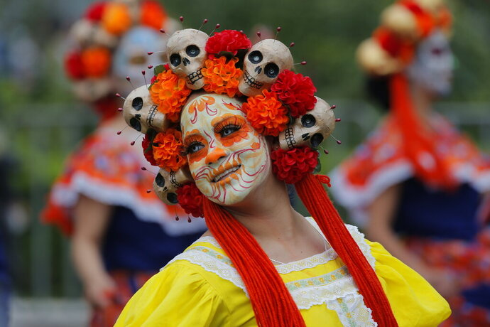 Performers participate in the Day of the Dead parade in Mexico City, Saturday, Nov. 2, 2019. (AP Photo/Ginnette Riquelme)