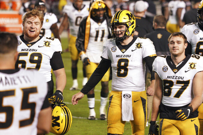 Missouri quarterback Connor Bazelak (8), Drake Heismeyer (69) and Cade Musser (87) walk off the field after an NCAA college football game against South Carolina, Saturday, Nov. 21, 2020, in Columbia, S.C. (AP Photo/Sean Rayford)