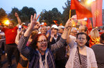 People protest against the change of the country's constitutional name in front of the Parliament building in Skopje, Macedonia, Wednesday, June 13, 2018. A historic deal ending a decades-long dispute between neighbors Greece and Macedonia over the latter's name met with mixed reactions in both countries Wednesday, with some welcoming the agreement and others horrified at what they see as unacceptable concessions. (AP Photo/Boris Grdanoski)
