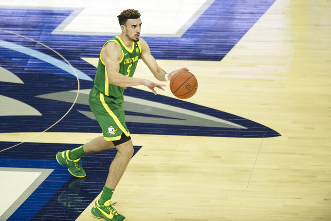 Oregon's Chris Duarte passes the ball against Seton Hall during the first half of an NCAA college basketball game in Omaha, Neb., Friday, Dec. 4, 2020. (AP Photo/Kayla Wolf)