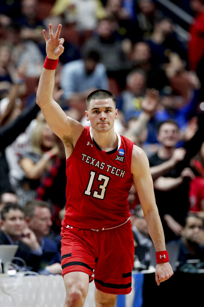 Texas Tech guard Matt Mooney celebrates after scoring against Michigan during the second half an NCAA men's college basketball tournament West Region semifinal Thursday, March 28, 2019, in Anaheim, Calif. (AP Photo/Jae C. Hong)