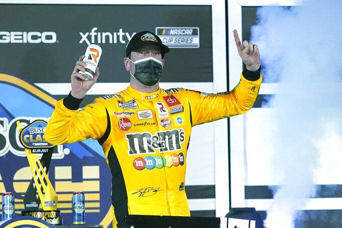 Kyle Busch celebrates in Victory Lane after winning the NASCAR Clash auto race at Daytona International Speedway, Tuesday, Feb. 9, 2021, in Daytona Beach, Fla. (AP Photo/John Raoux)