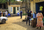 Police operate a checkpoint at the border crossing near Kasindi, eastern Congo Wednesday, June 12, 2019, just across from the Ugandan town of Bwera. In Uganda, a 5-year-old boy vomiting blood became the first cross-border victim of Ebola in the current outbreak on Wednesday, while two more people in Uganda tested positive for the highly contagious disease that has killed nearly 1,400 in Congo. (AP Photo/Al-hadji Kudra Maliro)