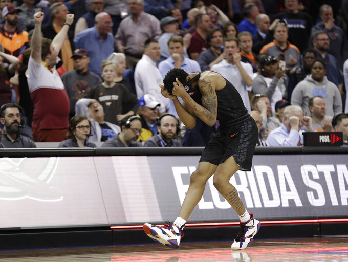 Virginia Tech's Nickeil Alexander-Walker reacts after missing a last-second basket in overtime of an NCAA college basketball game against Florida State in the Atlantic Coast Conference tournament in Charlotte, N.C., Thursday, March 14, 2019. (AP Photo/Chuck Burton)