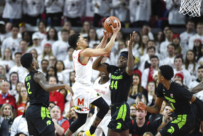 Maryland guard Anthony Cowan Jr. (1) goes to the basket for a layup during the first half against the of an NCAA college basketball game against the Michigan State, Saturday, Feb. 29, 2020, in College Park, Md. (AP Photo/Terrance Williams)