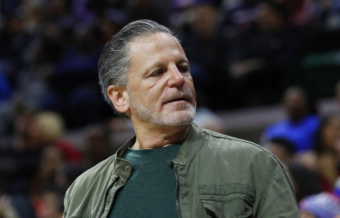 FILE- In an Oct. 12, 2018 file photo, Quicken Loans and Rock Ventures founder Dan Gilbert is seen during a basketball game in East Lansing, Mich. Gilbert is starting a ballot drive as a