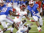 SMU cornerback Christian Davis (28) and safety Patrick Nelson (2) tackle Houston running back Chandler Smith (8) during the second half of an NCAA college football game Saturday, Nov. 3, 2018, in Dallas. (AP Photo/Brandon Wade)