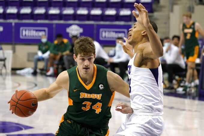 North Dakota State forward Rocky Kreuser (34) drives against TCU forward Jaedon LeDee (23) in the first half of an NCAA college basketball game in Fort Worth, Texas, Tuesday, Dec. 22, 2020. (AP Photo/Tony Gutierrez)