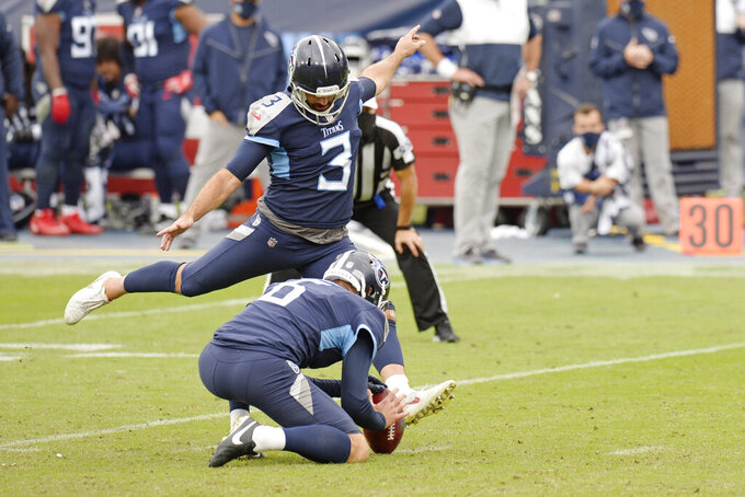 Tennessee Titans kicker Stephen Gostkowski (3) kicks the extra point to tie the game against the Houston Texans in the final seconds of the fourth quarter during an NFL football game Sunday, Oct. 18, 2020, in Nashville, Tenn. The Titans won in overtime 42-36. (AP Photo/Mark Zaleski)