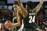 Georgia forward Nicolas Claxton (33) moves the ball while being defended by Vanderbilt forward Aaron Nesmith (24) during an NCAA college basketball game, Wednesday, Jan. 9, 2019 in Athens, Ga. (Joshua L. Jones/Athens Banner-Herald via AP)