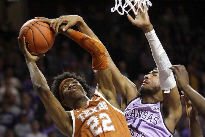 Texas forward Kai Jones (22) is fouled by Kansas State forward Antonio Gordon (11) during the first half of an NCAA college basketball game in Manhattan, Kan., Saturday, Feb. 22, 2020. (AP Photo/Orlin Wagner)
