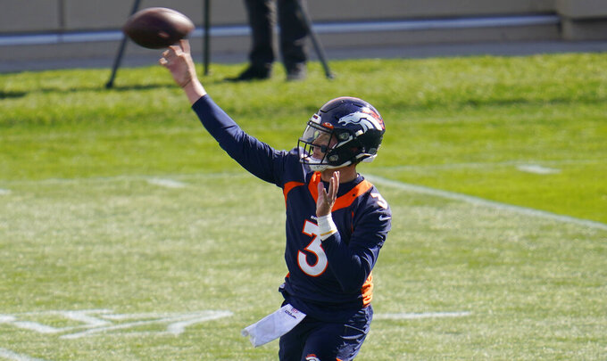 Denver Broncos quarterback Drew Lock warms up before taking part in drills during an NFL football practice Wednesday, Oct. 14, 2020, at the team's headquarters in Englewood, Colo. (AP Photo/David Zalubowski)