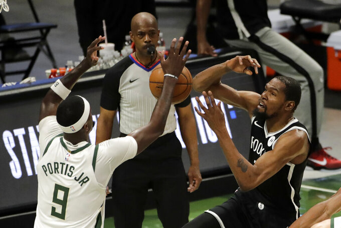 Brooklyn Nets' Kevin Durant is fouled as he shoots against Milwaukee Bucks' Bobby Portis (9) during the first half of an NBA basketball game Tuesday, May 4, 2021, in Milwaukee. (AP Photo/Aaron Gash)